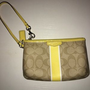 Coach yellow and beige wristlet